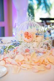 quinceanera centerpieces for tables cinderella coach reception table decor at a disneyland wedding