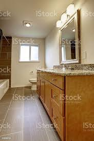 what color cabinets with beige tile bathroom in brown color with beige tile trim stock photo image now