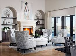 white and grey feature throughout this high ceiling living room