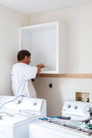 how to install base cabinets in laundry room mudroom update installing wall cabinets laundry room diy