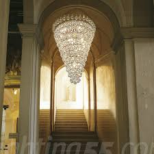 beautiful crystal chandelier in stairway of traditional formal