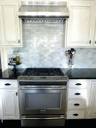 white ceramic tile backsplash galley kitchen with subway white