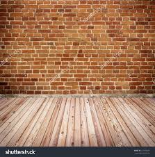 red brick wall with wooden floor texture interior stock photo