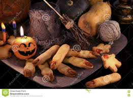 halloween still life with finger cookies and witch objects in