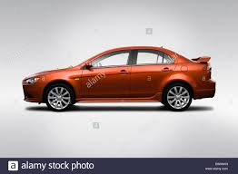 2009 Mitsubishi Lancer Ralliart In Orange Drivers Side Profile