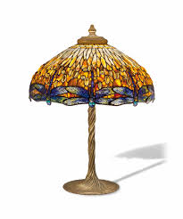 tiffany glass continues to make lighting magical perfectly suited to the shade s shape dragonflies were a popular motif that tiffany adapted to
