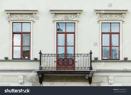 three windows row balcony on facade stock photo 442692613