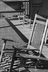 rocking chair porch in black and white photograph by suzanne gaff