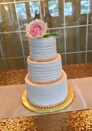 red velvet wedding cake with buttercream frosting and large