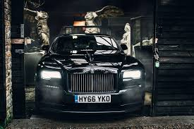 rolls royce outside driving the black badge rolls royce wraith mr goodlife