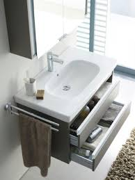 small bathroom vanity cabinet with interesting corner sink for