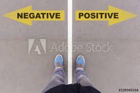 Sho Kafen negative vs positive text arrows on asphalt ground and sho