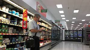 ufa russia 05 06 2016 ufa may 15 a girl chooses food in the supermarket auchan on may