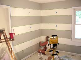 Wall Painting Tips by Andrea Arch Diy How To Paint Perfect Wall Stripes