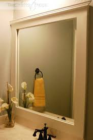 Frame Your Bathroom Mirror White Wall Paint Mirror With Black Wooden Frame Wall Lamps Ring