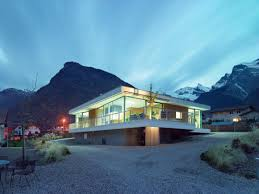 U Shaped House by Tiered U Shaped Slope Home Features Exposed Steel Elements