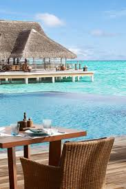 what we love thatch roofed overwater villas personal butlers