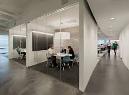 best 25 corporate office design ideas on pinterest glass office blue eames chairs provide a splash of color in the cool interiors of the dallas office of tm advertising