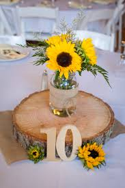 sunflower wedding decorations wooden slab centerpiece and table number wedding decor ideas