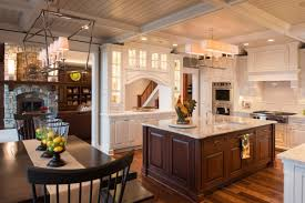 white kitchen cabinets with island traditional white kitchen with cherry island