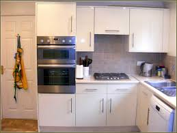 How To Change Kitchen Cabinet Doors Marble Contertops Electric Stove And Oven Wooden Kitchen Cabinets