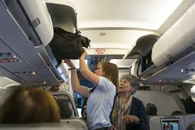 united airlines international carry on the new thin line between carry on and checked bags wsj