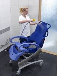shower chair with armrests on casters with cutout seat