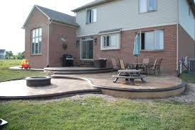 Backyards Ideas Patios by Custom Designed Stamped Concrete Patio W Built In Fire Pit