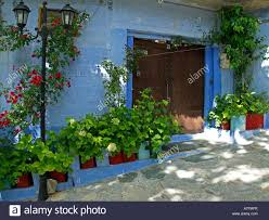 entrance of an old house with flowers in the village ambélakia