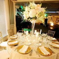 tables alternated with a mix of tall and short floral arrangements