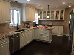traditional kitchen with painted white cabinets and glass case