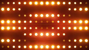 bright floodlights turning on and orange see more color