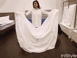 How To Fold A Fitted Bed Sheet How To Fold A Fitted Sheet Instyle Com