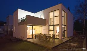 cozy look of best modern home designs showing beige wall and glass