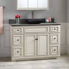 modern white painted wooden vanity decor with curved door and art