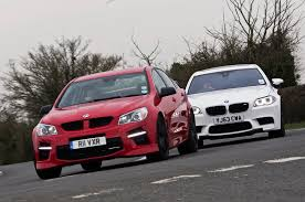 battle of the super saloons vauxhall vxr8 takes on the bmw m5