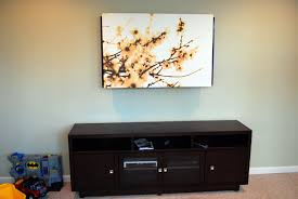 wall mounted tv hiding cables remodelaholic 95 ways to hide or decorate around the tv
