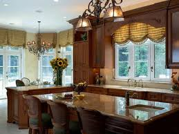 kitchen designed with wooden cabinets and balloon valances with