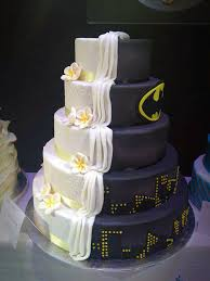 themed wedding cakes split cake design is half batman themed half ordinary wedding cake