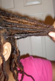 interlocking hair using dual type twisting palm rolling interlocking loc d and