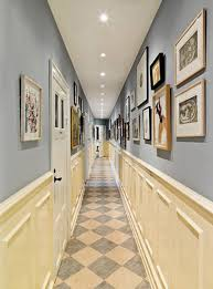 small and narrow hallway with photo decor and chic look small