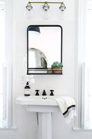 How To Hang Bathroom Mirror How To Hang A Bathroom Mirror On Ceramic Tile Apartment Therapy