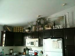 decorating themed ideas for kitchens afreakatheart decorating cabinets fascinating decorating above kitchen cabinets