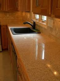 Kitchen Counter Tile - not fond of the mismatched appliances or a cat on counter but the