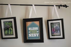 our love nest diy project curtain rod picture frame hanger