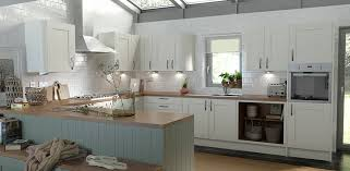 sage and cream kitchen with oak worktop from wren kitchens new