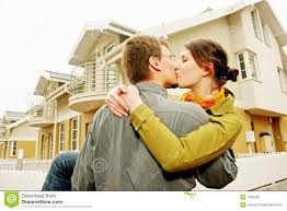 couple in front of one family house royalty free stock photo