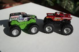 grave digger toy monster truck lot of 2 wheels monster jam red avenger diecast and green
