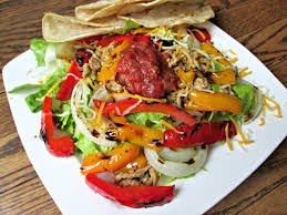 grilled pepper and onion taco salad with chipotle ranch dressing