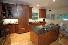 brown cherry wooden kitchen island and kitchen cabinet with black